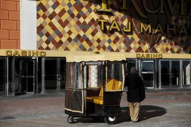 A pedicab driver waits for riders outside the Trump Taj Mahal Casino in Atlantic City, New Jersey, January 20, 2016. REUTERS/Shannon Stapleton