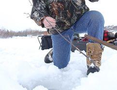 Denis Hogan ice fishes on Ramsey Lake. Sudbury Star file photo
