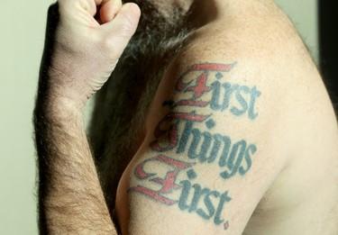 Ottawa city Coun. Jeff Leiper shows off one of his tattoos.