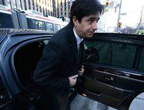 Jian Ghomeshi arrives at Toronto City Hall court on Monday Feb. 1, 2016. (Craig Robertson/Postmedia Network)