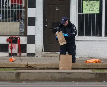 Toronto Police at the scene on Spadina Ave. Sunday, January 31, 2016 after five people were shot, killing two. (Dave Thomas/Toronto Sun)