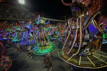 Revelers of the Unidos da Tijuca samba school perform during the second day of carnival parade in the Sambodrome in Rio de Janeiro, Brazil on February 17, 2015. AFP PHOTO/YASUYOSHI CHIBA