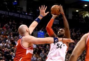 Toronto Raptors forward Patrick Patterson shoots the ball past the hand of Washington Wizards center Marcin Gortat. (Dan Hamilton/USA TODAY Sports)