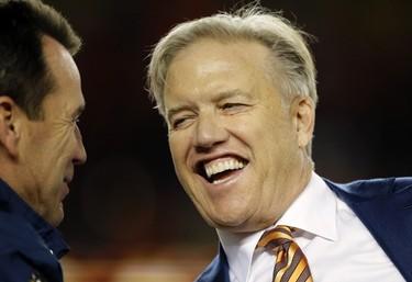 Denver Broncos general manager John Elway smiles with head coach Gary Kubiak, left, during the trophy presentation after the NFL Super Bowl 50 football game Sunday, Feb. 7, 2016, in Santa Clara, Calif. The Broncos won 24-10. (AP Photo/Ben Margot)