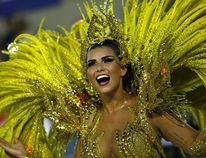 Drum queen Bianca Leao, from Uniao da Ilha samba school, dances during Carnival parade at the Sambadrome, in Rio de Janeiro, Brazil, Sunday, Feb. 7, 2016. (AP Photo/Silvia Izquierdo)