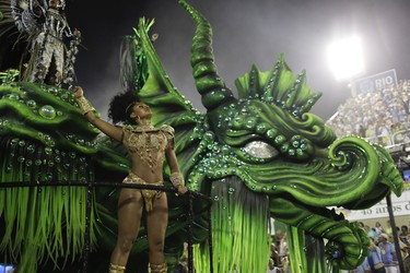 A performer from Mocidade samba school parades on a float during the Carnival celebrations at the Sambadrome in Rio de Janeiro, Brazil, Monday, Feb. 8, 2016. (AP Photo/Leo Correa)