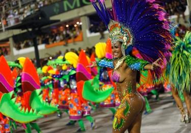 A performer from the Uniao da Ilha samba school dances during Carnival celebrations at the Sambadrome in Rio de Janeiro, Brazil, Sunday, Feb. 7, 2016. (AP Photo/Silvia Izquierdo)