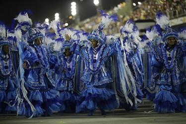 Performers from Unidos da Tijuca samba school parade during the Carnival celebrations at the Sambadrome in Rio de Janeiro, Brazil, Monday, Feb. 8, 2016. (AP Photo/Leo Correa)