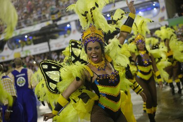 Performers from the Unidos da Tijuca samba school parade during carnival celebrations at the Sambadrome in Rio de Janeiro, Brazil, Monday, Feb. 8, 2016. (AP Photo/Silvia Izquierdo)