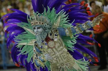 A performer from Uniao da Ilha samba school parades during Carnival celebrations at the Sambadrome in Rio de Janeiro, Brazil, Sunday, Feb. 7, 2016. (AP Photo/Leo Correa)