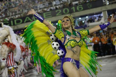 A performer from Grande Rio samba school parades during the Carnival celebrations at the Sambadrome in Rio de Janeiro, Brazil, Monday, Feb. 8, 2016. (AP Photo/Leo Correa)