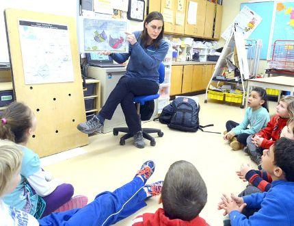 Community education technician Maranda MacKean shares a story of water safety with grade 2 pupils at Hamlet Public School on Monday. (SCOTT WISHART, The Beacon Herald)