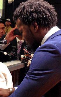 Carolina CB Josh Norman emotionally reacting to having Peyton Manning's post-game presser shown on a big-screen TV on the Panthers' side of the post-game media hall. (JOHN KRYK, POSTEMDIA NETWORK)