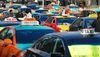Taxi cabs protest Uber on Bay St. beside Toronto City Hall on December 9, 2015. (Michael Peake/Toronto Sun)