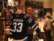 Dylan Schwark, Jets Gear Store manager, is happy Dustin Byfuglien will stay in Winnipeg.