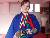 Delayne Rowland, 14, a judo athlete, shows off her most recent medals on Saturday February 6, 2016 at the Kita Kaze Judo Club in Grande Prairie, Alta. Logan Clow/Grande Prairie Daily Herald-Tribune/Postmedia Network