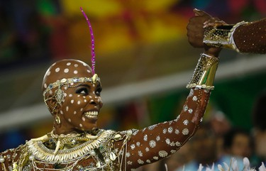 A performer from the Mangueira samba school parades during carnival celebrations at the Sambadrome in Rio de Janeiro, Brazil, Tuesday, Feb. 9, 2016. (AP Photo/Silvia Izquierdo)