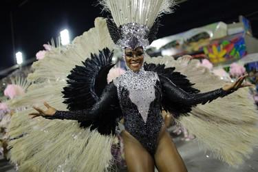 Performer from the Mangueira samba school dances during carnival celebrations at the Sambadrome in Rio de Janeiro, Brazil, Tuesday, Feb. 9, 2016. (AP Photo/Silvia Izquierdo)