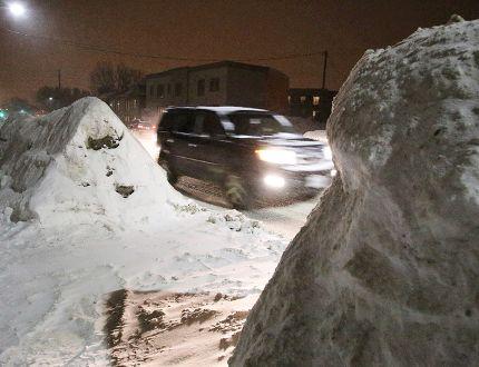<p>Massive snowbanks are making driving dangerous on Regent Street in Sudbury, Ont. on Wednesday February 10, 2016. Gino Donato/Sudbury Star/Postmedia Network