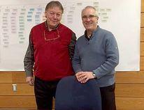 Walpole Island First Nation Chief Dan Miskokomon, left, and YMCA Southwestern Ontario president and CEO Jim Janzen sign a memorandum of understanding. (Submitted photo)