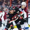 Ottawa Senators right winger Chris Neil battles with Colorado Avalanche defenceman Chris Bigras during NHL action in Ottawa on Feb. 11, 2016. (Errol McGihon/Postmedia)