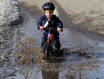 Riding a bike through puddles