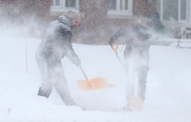 A couple shovel out their driveway in Ottawa, Feb 16, 2016.  (Tony Caldwell/Postmedia Network)