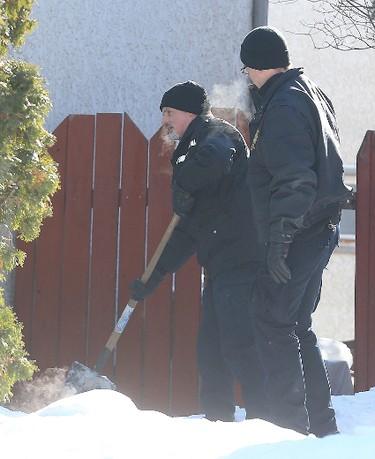 Winnipeg Police search for evidence on Bayne Crescent in Winnipeg, Man. Sunday February 21, 2016 following the discovery of the body of missing teen Cooper Nemeth. Brian Donogh/Winnipeg Sun/Postmedia Network