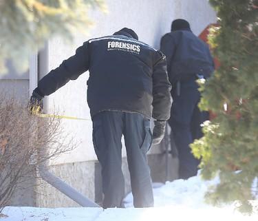 Winnipeg Police take measurements on Bayne Crescent in Winnipeg, Man. Sunday February 21, 2016 following the discovery of the body of missing teen Cooper Nemeth. Brian Donogh/Winnipeg Sun/Postmedia Network