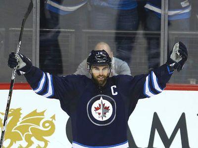 Winnipeg Jets left winger Andrew Ladd celebrates his second period goal against the Dallas Stars during NHL hockey in Winnipeg, Man. Tuesday February 23, 2016.  Brian Donogh/Winnipeg Sun/Postmedia Network