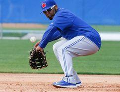 Blue Jays first baseman/designated hitter Edwin Encarnacion wants to sign a new contract, but won't be negotiating during the regular season. (Stan Behal/Toronto Sun/Files)