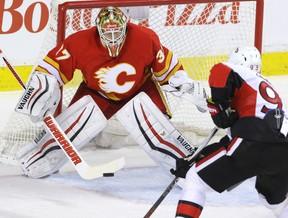 Calgary Flames goalie Joni Ortio stops Ottawa Senators Mike Zibanejad in NHL hockey action at the Scotiabank Saddledome in Calgary, Alta. on Saturday February 27, 2016. (Mike Drew/Postmedia)