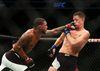 Michael Johnson lands a shot to Nate Diaz's face at UFC Fight Night on Saturday, Dec. 19, 2015, in Orlando, Fla. (Jacob Langston/Orlando Sentinel via AP)