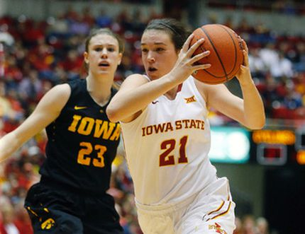 Iowa State's Bridget Carleton of Chatham drives past Iowa's Christina Buttenham on Friday, Dec. 11, 2015, in Ames, Iowa. (RACHEL MUMMEY//The Des Moines Register via AP)