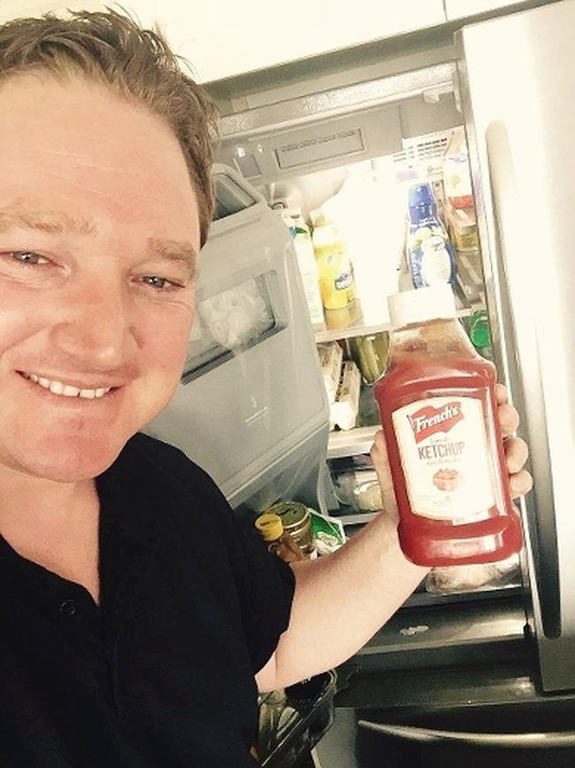 Taras Natyshak, New Democrat MPP for Essex, holds a bottle of French's ketchup by his fridge. (Postmedia Network)