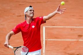 Canada's Frank Dancevic serves to Belgium's Steve Darcis during the first singles match of the Davis Cup World Group Quarterfinals between Belgium and Canada, in Middelkerke, Belgium, on July 17, 2015. (THE CANADIAN PRESS/AP/Geert Vanden Wijngaert)