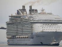 The Harmony of the Seas ( Oasis 3 ) class ship leaves the STX Les Chantiers de l'Atlantique shipyard site in Saint-Nazaire