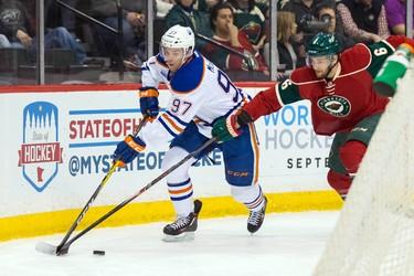 Mar 10, 2016; Saint Paul, MN, USA; Minnesota Wild defenseman Marco Scandella (6) defends Edmonton Oilers forward Connor McDavid (97) in first period at Xcel Energy Center. Mandatory Credit: Brad Rempel-USA TODAY Sports