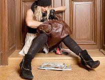 Woman looking for keys in purse - lost keys