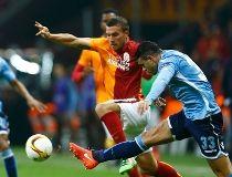 Galatasaray's Lukas Podolski and Lazio's Mauricio in action.   REUTERS/Osman Orsal