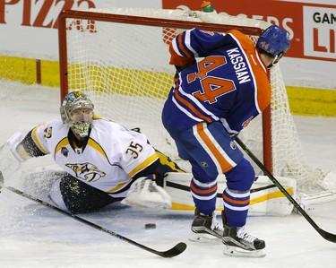 EDMONTON, ALBERTA: MARCH 14, 2016 - Nashville Predators goalie Pekka Rinne makes a save on Edmonton Oiler Zack Kassian (right) during second period NHL hockey game action in Edmonton on Monday March 14, 2016. (PHOTO BY LARRY WONG/POSTMEDIA NETWORK)