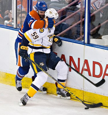 Nashville Predators' Roman Josi (59) is grabbed by Edmonton Oilers' Zack Kassian (44) during third period NHL action in Edmonton, Alta., on Monday March 14, 2016. THE CANADIAN PRESS/Jason Franson