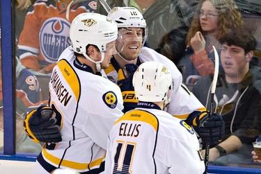 Nashville Predators' Ryan Johansen (92), James Neal (18) and Ryan Ellis (4) celebrate a goal against the Edmonton Oilers during third period NHL action in Edmonton, Alta., on Monday March 14, 2016. THE CANADIAN PRESS/Jason Franson