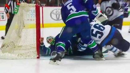 Vancouver Canucks goalie Jacob Markström makes an incredible save.