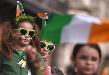 Children watch the St. Patrick's day parade in Dublin, Ireland March 17, 2016. REUTERS/Clodagh Kilcoyne