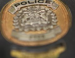 Calgary Police Service badge. (Jim Wells/Postmedia)