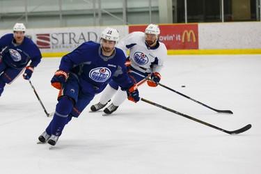 Edmonton's Jordan Eberle (14) skates with Luke Gazdic (20) during an Edmonton Oilers practice at Leduc Recreation Centre in Leduc, Alta., on Friday April 8, 2016. Photo by Ian Kucerak