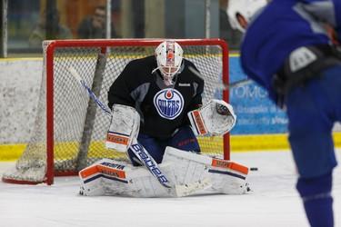 Edmonton's goaltender Laurent Brossoit (1) makes a save during an Edmonton Oilers practice at Leduc Recreation Centre in Leduc, Alta., on Friday April 8, 2016. Photo by Ian Kucerak