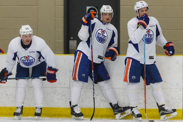Edmonton's Mark Letestu (55), Lauri Korpikoski (28) and Anton Lander (51) watch during an Edmonton Oilers practice at Leduc Recreation Centre in Leduc, Alta., on Friday April 8, 2016. Photo by Ian Kucerak