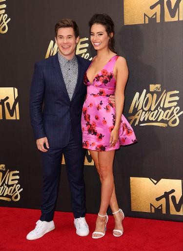 Adam DeVine and Chloe Bridges arrive at the 2016 MTV Movie Awards in Burbank, California April 9, 2016. (Brian To/WENN.COM)